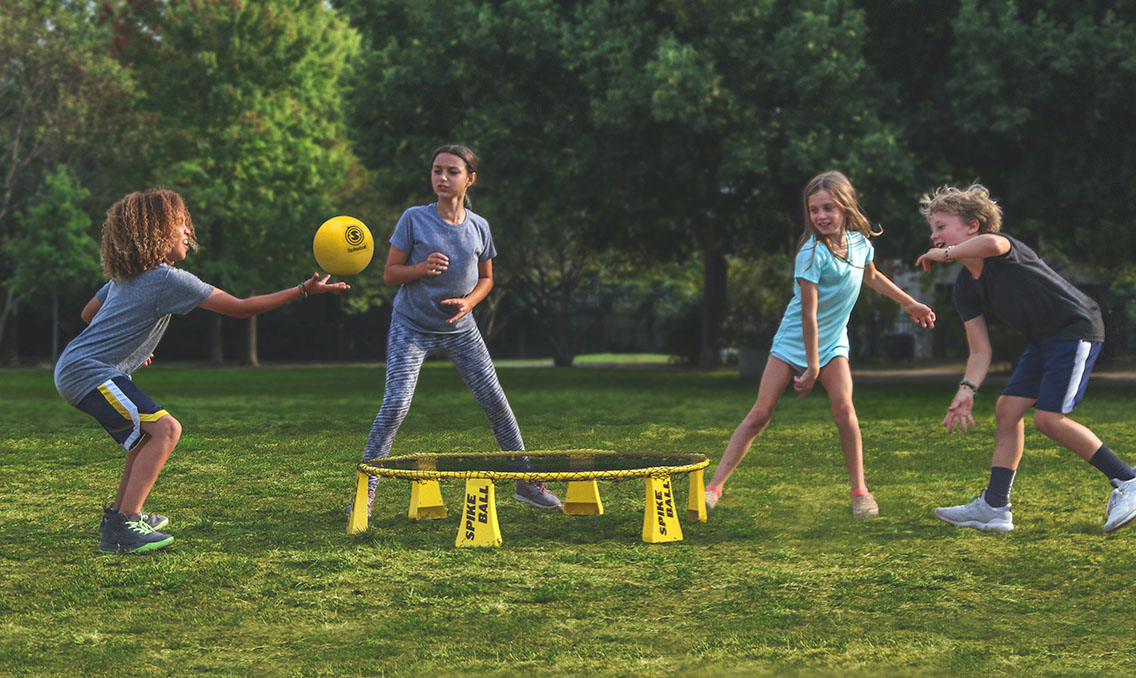 Kids reconnecting with spikeball at VBS 2021